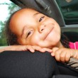 little girl riding in car