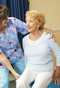 nurse assisting senior citizen lady