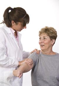 nurse examining shoulder