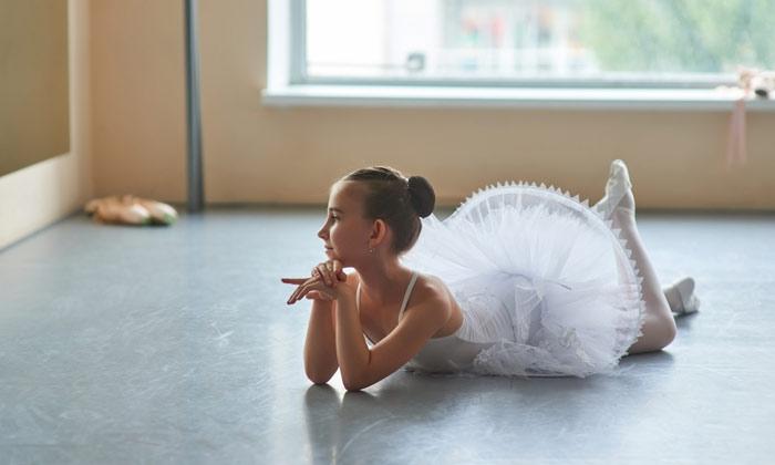 young ballerina girl relaxing resting on floor