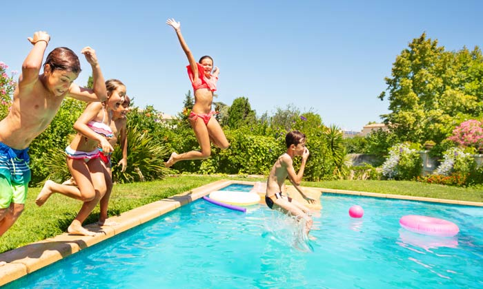 group of kids jumping into swimming pool