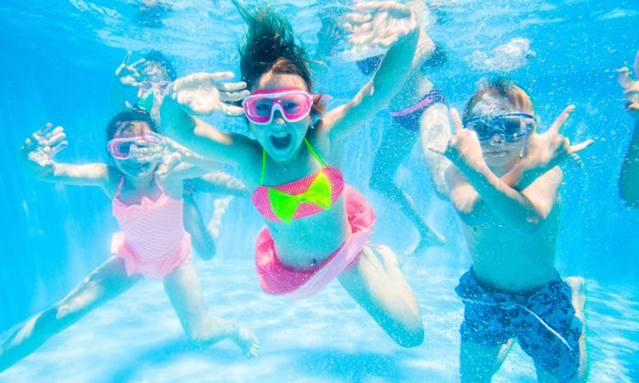 underwater goggle kids swimming happily