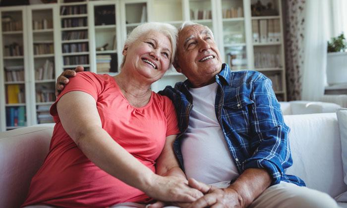 happy elderly couple on sofa