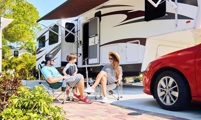 happy family on vacation with camper