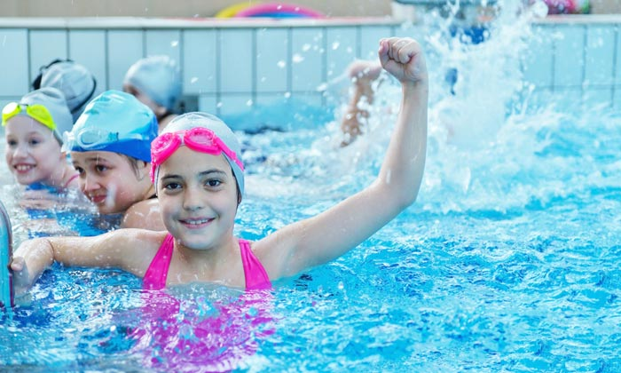 joyful students in swim school