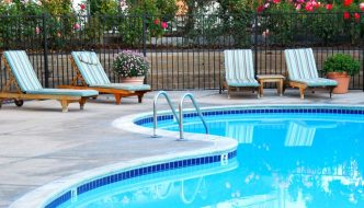pool chairs beside swimming pool