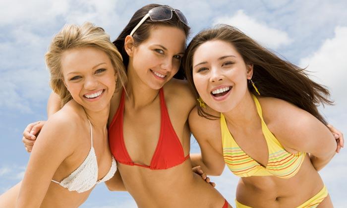 three teenage girls in bikinis