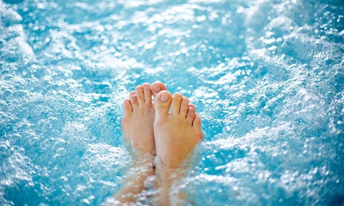 hot tub water bubbles tickling womans feet