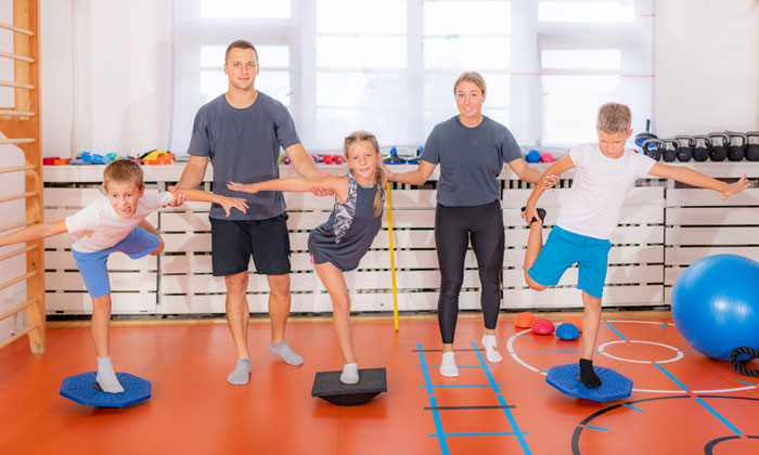 fitness instructors helping students learn balance