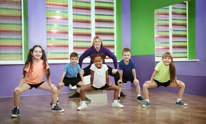 teacher with group of fitness students