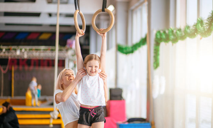 young gymnastics student excited about learning new things