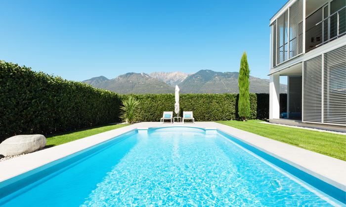 clear water inground pool with scenic mountain view