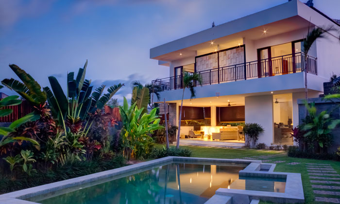 inground pool with fern gardens